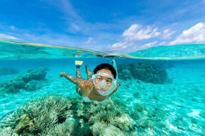Pete Atkinson-female snorkeller-coral reef-Cocos (Keeling)